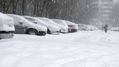 People Struggling To Walk On A Snow Covered Alley, Cars Almost Buried In Snow Stock Footage