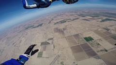 Men and women sky diving and parachuting. Stock Footage