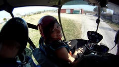 Men and women sky diving and parachuting out of a helicopter. Stock Footage