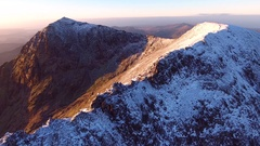 Gorgeous aerial shot towards the summit of Crib Goch, Snowdonia. Stock Footage