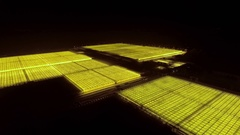 Agricultural industrial greenhouse area, 4k aerial night view Stock Footage