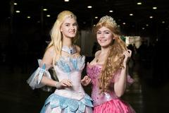 Two young woman cosplayer wearing beautiful dres Stock Photos