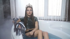 The girl in the crown posing in the jacuzzi Stock Footage