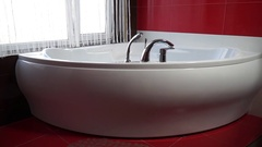 Zoom a white bath in red bathroom Stock Footage