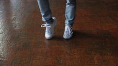 Female feet dancing breakdance on the dance floor, Close-up shot of dancing feet Stock Footage