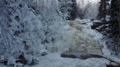 AERIAL: Yukankoski in winter - a waterfall on the river in Karelia, Russia Stock Footage