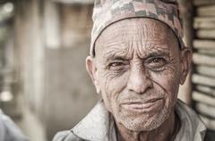Wrinkled face in Nepal Stock Photos