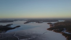 Aerial view:Ladoga Lake Skerries with bird's eye view on winter morning, Karelia Stock Footage