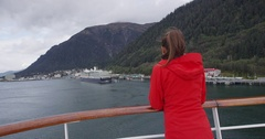 Alaska Cruise ship passenger in Juneau harbor looking at city view Stock Footage