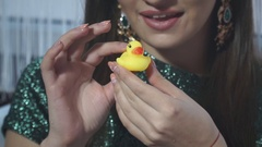 Close-up of a little yellow rubber duck in the hands of the model Stock Footage