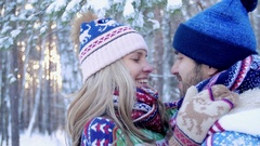 Romantic young couple kissing and enjoying their time in the winter forest Stock Footage