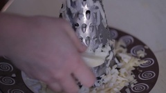 Grate the potatoes on a grater Stock Footage