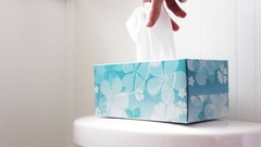 Hand picks out tissue from tissue box in modern bathroom Stock Footage