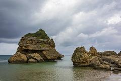 Large coastal boulders of volcanic origin Stock Photos