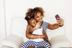 Adorable sweet young afro-american mother with cute little daugh Stock Photos