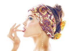 Young pretty modern girl with bright shawl on head emotional posing isolated on Stock Photos