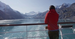 Alaska cruise ship passenger tourist looking at glacier in Glacier Bay Stock Footage