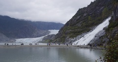 Alaska glacier landscape - tourists visiting Mendenhall Glacier attraction Stock Footage