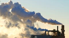 Beautiful sunlit Industrial Smokestack emissions in subzero Winter air Stock Footage