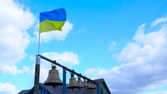 The flag flying in the wind close to the bells Stock Footage