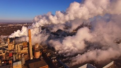 Beautiful sunlit Factory Smokestack emissions in subzero Winter air Stock Footage