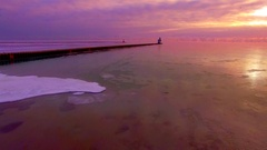 Flying out over Lake Michigan in minus one degrees Fahrenheit Stock Footage