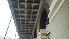 Stabilized walking shot looking up at the architecture of historic building Stock Footage