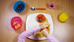 4K Young child cutting pancakes with knife and fork Stock Footage