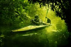Special forces in the military kayak in the jungle Kuvituskuvat