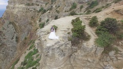 Aerial video of a married couple on the edge of cliffs at Cape Fiolent. Stock Footage