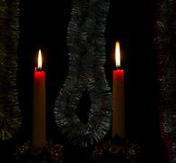 Two festive candles burn in the twilight Stock Photos