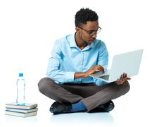 African american college student sitting with laptop on white Stock Photos