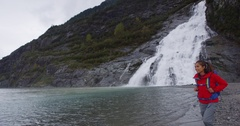 Alaska glacier landscape - tourist visiting Mendenhall Glacier attraction Stock Footage