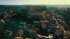 Aerial shot flying from view of entire Ragusa Ibla towards piazza Stock Footage