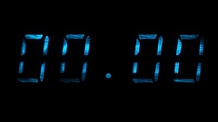 Digital clock display shows time of 00 hours 00 minutes to 00 hours 01 minutes Stock Footage
