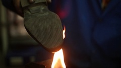 Shoemaker making shoes. Working with fire at cobbler workshop. Slow motion. Stock Footage