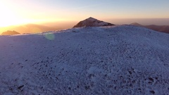 Establishing aerial reveal of Crib Goch and Mount Snowdon at sunrise. Stock Footage