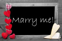 Black And White Blackbord, Hearts, Text Marry Me Stock Photos