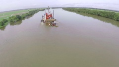 Floating platform of extraction on a water course in Africa. Aerial. Stock Footage