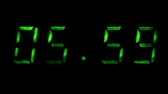Digital clock shows time of 05 hours 59 minutes to 06 hours 00 minutes Stock Footage