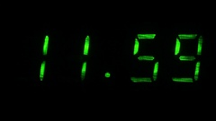 Digital clock shows the time of 11 hours 59 minutes to 12 hours 00 minutes Stock Footage