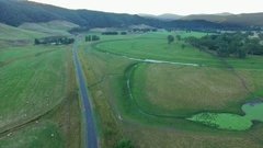 Forward flight over Omeo Highway and Mitta Mitta Valley countryside Stock Footage