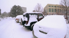 Parking lot with cars covered with snow after the winter storm. Stock Footage