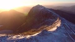 Panning aerial shot of Snowdonia at sunrise. Stock Footage