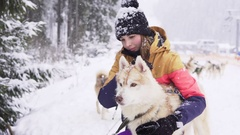 Beautiful girl hugging the dog. The girl with the siberian husky Stock Footage