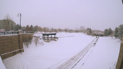Urban park covered with fresh snow after the winter storm. Stock Footage