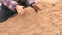 Hands of little kid playing with sand Stock Footage