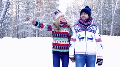 Tender couple walking together in the forest on a beautiful winter day Stock Footage