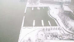 Snowy Rooftop View of North Cove Yacht Harbor Battery Park City Stock Footage