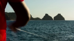 Fishing in Fernando de Noronha two brothers rock Stock Footage